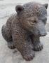 Siiting Bear Cub